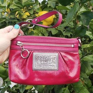 Coach Poppy patent leather pink wristlet